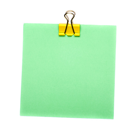green Stick Note with yellow paper clip holder isolated on white background. Mock up.