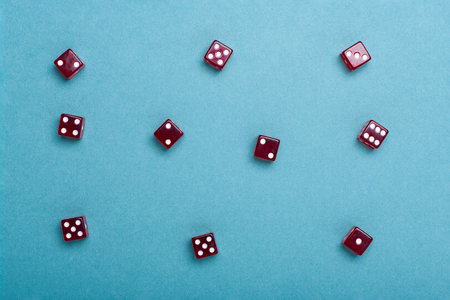 casino concept with red Dice on green background. Stock Photo