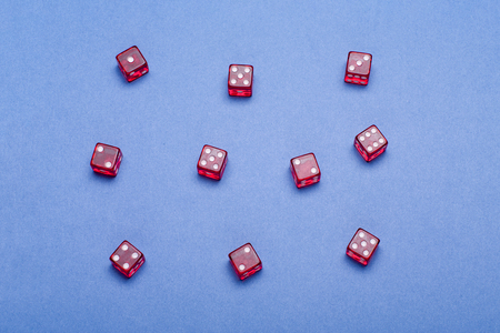 casino concept with red Dice on blue background. Stock Photo