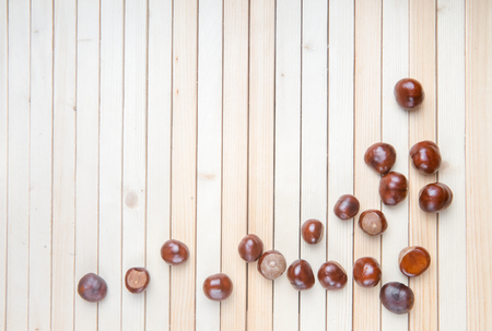 Horse Chestnut for Christmas on wooden background. With your place for the text. Top view.