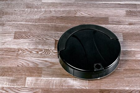 Robotic vacuum cleaner controlled by voice commands for direct cleaning. modern smart home cleaning device.
