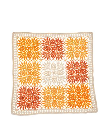 Crocheted vintage square napkin. delicate, elegant pattern in form of bright, multi-colored flowers. Knitted ornament. isolated on white background. Concept of interior design.
