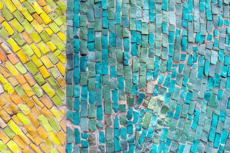 Fragment of wall with decorative mosaic. Abstract background of blue and yellow smalt. Fashion texture, minimal concept, copy space. For Your Design of Templates, Postcards with space for Text.