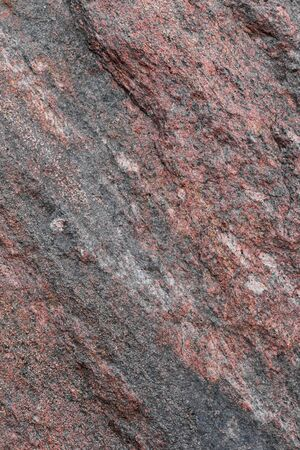 pattern and texture of natural untreated granite layers. stone surface for background.