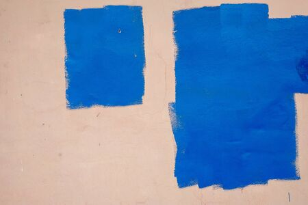 pink wall with two blue rectangles. empty copy space to write descriptive text.