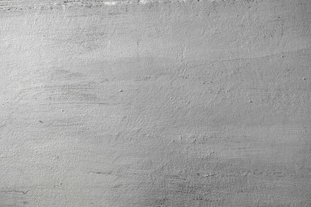 Concrete texture of wall painted in silver color with rough surface. Abstract background.