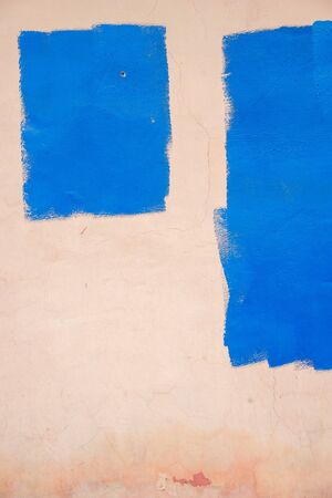 Fragment of pink wall with blue areas painted over. Empty form with place for text and copy space. Imagens