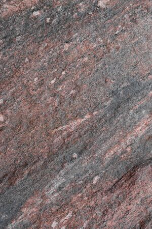 Natural untreated granite stone surface for background. Imagens