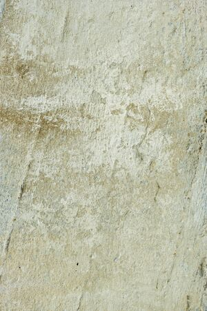 Texture of dirty concrete old cracked street wall. Abstract vertical background.