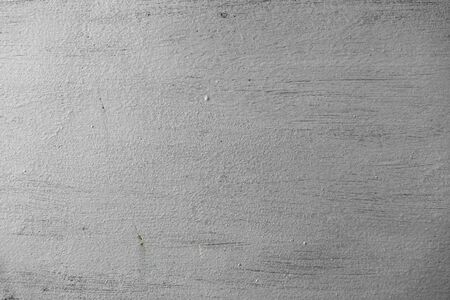 Rough surface of the wall painted in silver color. Abstract textured background. Empty space.
