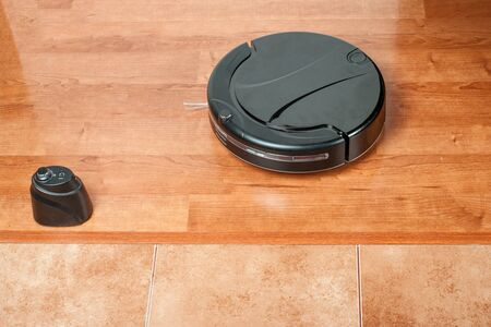 Virtual wall does not let vacuum cleaner on tile floor. Barrier uses infrared beam to block robot from doorways and other off-limit areas.