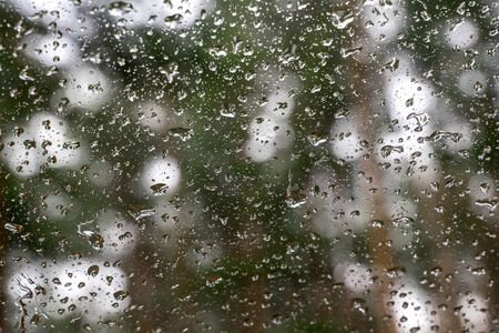 Water drops on car window. Rain on surface of window closeup. Natural background for your design. selective focus.