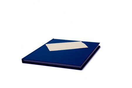 Blue notepad with blank sticker on white background photo