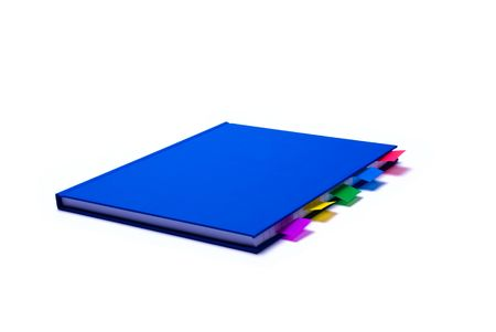 Blue notepad with colorfull bookmarks on white background photo