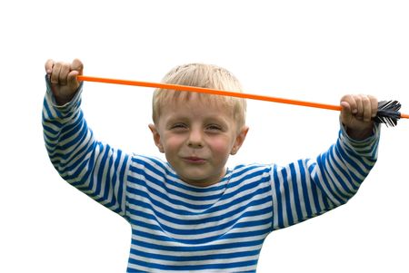 The smiling boy in a striped T-short with the hands lifted upwards in which holds a toy arrow Stock Photo - 3624929