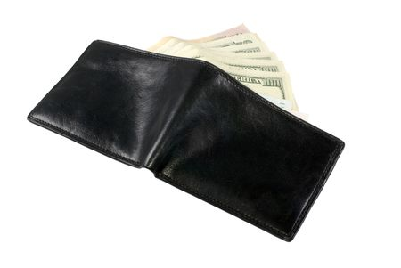 The opened wallet from which the dollar denominations spread out by a fan are visible photo