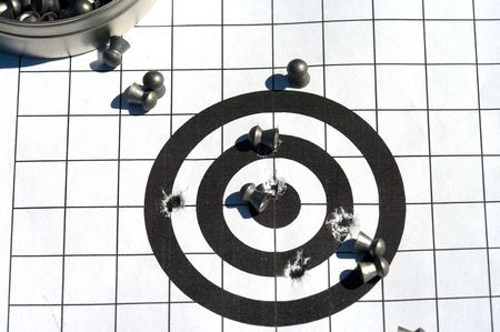 The punched ranging target and bullets for a airgun. photo