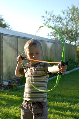 The child on a country site to bend a bow Stock Photo