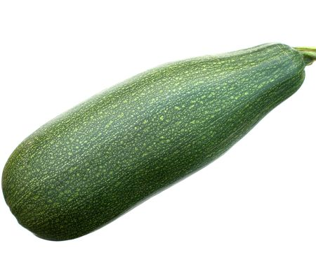 Green vegetable marrow on a white background a close up. Stock Photo - 5639548