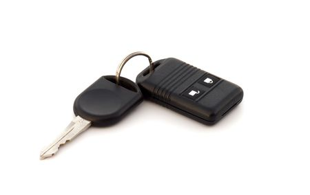Car key and alarm system charm, close up on a white background.