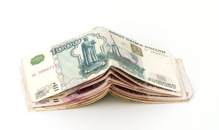 encash: Pile of rouble banknotes on a white background.