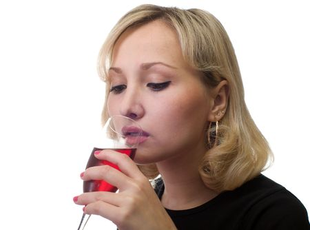 The female drinks red wine from a glass. photo