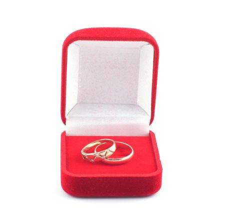 Red box with two gold wedding rings on a white background. Stock Photo - 6452410