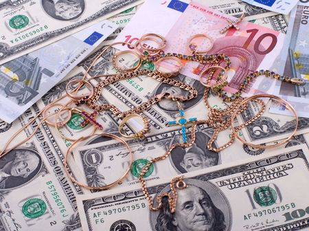 The background of the bills of dollars and euros and jewelry.