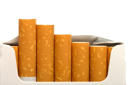 Open a pack of filtered cigarettes closeup isolated on a white background. Stock Photo - 7421949