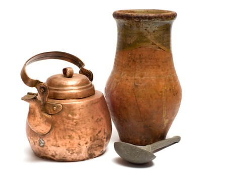 The old copper kettle, pewter spoon and ceramic  pot on a white background.