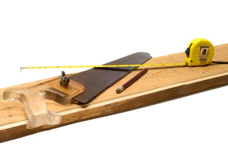 Tools on a board it is isolated on a white background.