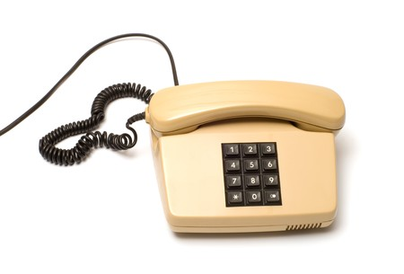 Old Beige key telephone system on a white background.