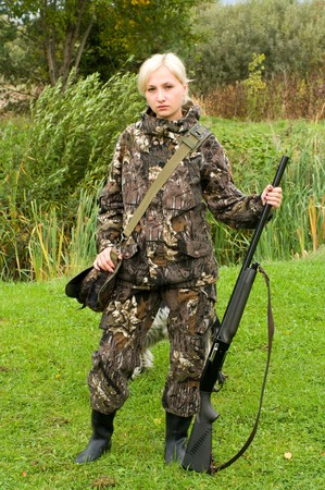 Blond girl in camouflage with a shotgun. Stock Photo - 8006929