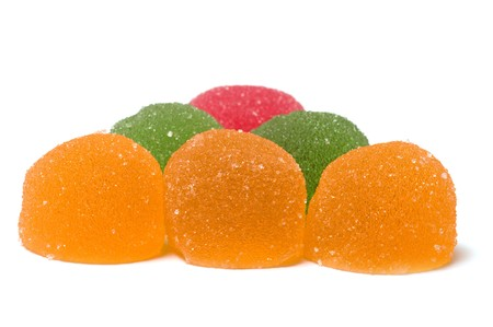 Multi-colored fruit candy on a white background.