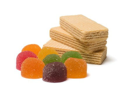 Multi-colored fruit candy and wafers on a white background. Stock Photo - 8133656