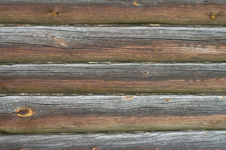 Fragment of a wall of an old rural log house. Stock Photo