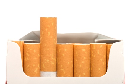 Open a pack of filtered cigarettes closeup isolated on a white background. Stock Photo - 8291656