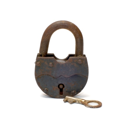 Old rusty padlock and key on white background.