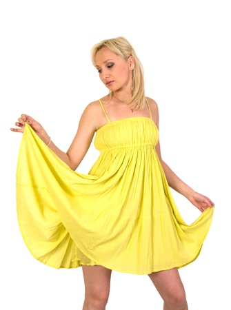 The girl in a yellow summer dress it is isolated on a white background. Stock Photo - 8649610