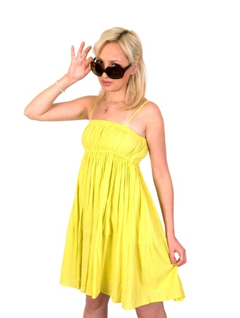 Girl in a yellow summer dress and sunglasses isolated on white background