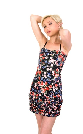 Girl in a flowery summer dress on a white background.