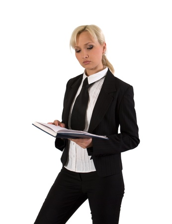Blonde in a business suit reads diary. photo