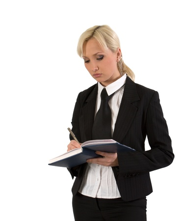 Businesswoman takes notes in a diary against white background. photo