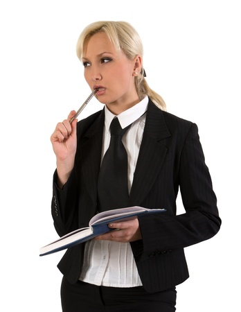 disbelieve: Thoughtful young woman with organizer and a pen against white background. Stock Photo