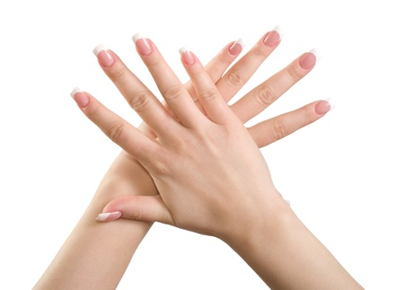 Female hands with French manicure isolated on white background.
