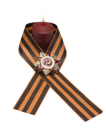 Burning candles Ribbon of Saint George and the Order of the Patriotic War.
