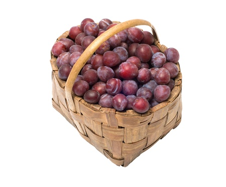 Wattled basket with ripe plums it is isolated on a white background. Stock Photo - 10443600