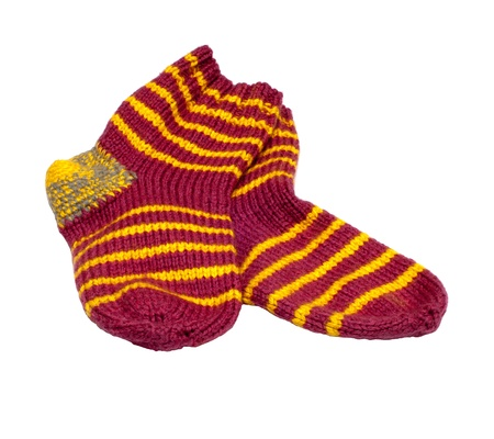 Pair of knitted woolen socks it is isolated on a white background.