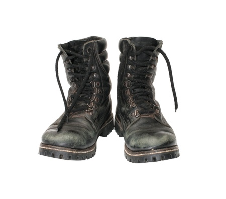 Pair worn army boots it is isolated on a white background.