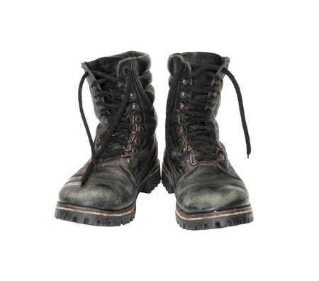 botas: Par usar botas militares se encuentra aislado en un fondo blanco.
